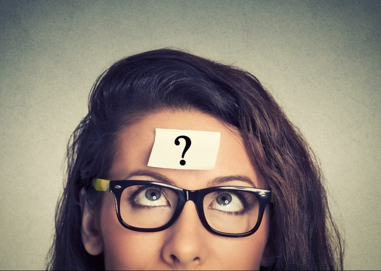 girl with a question mark on her forehead