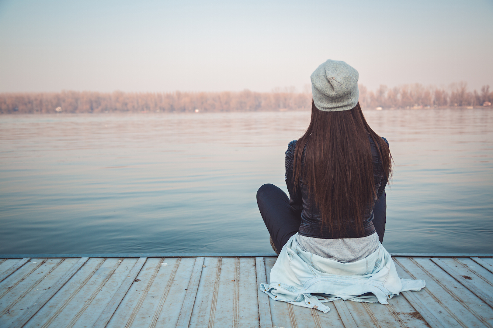 woman gazing at a lake