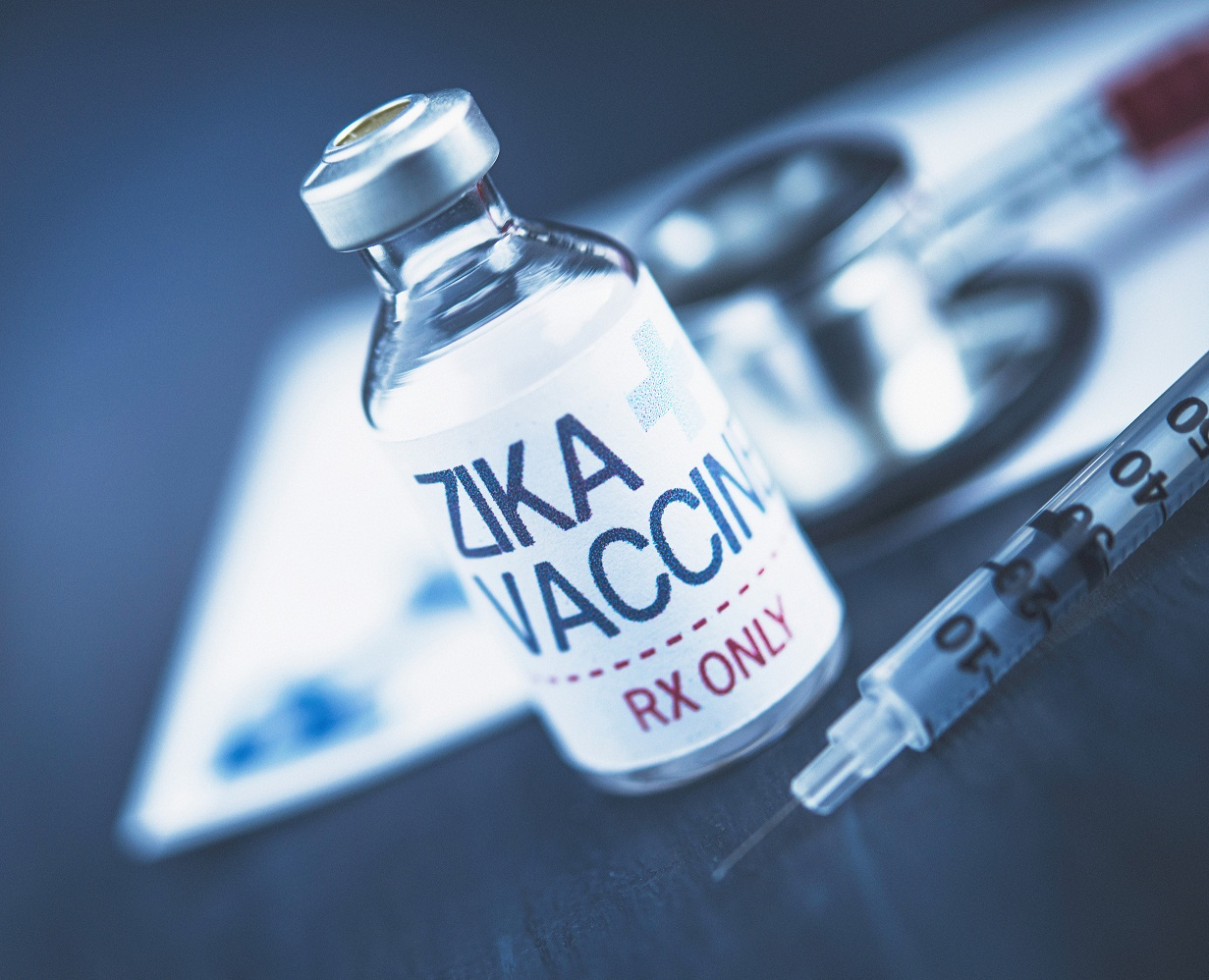 Conceptual shot of zika vaccine with syringe and stethoscope