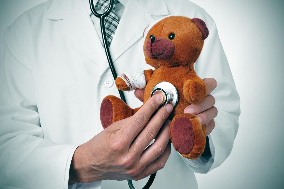 doctor auscultating a teddy bear