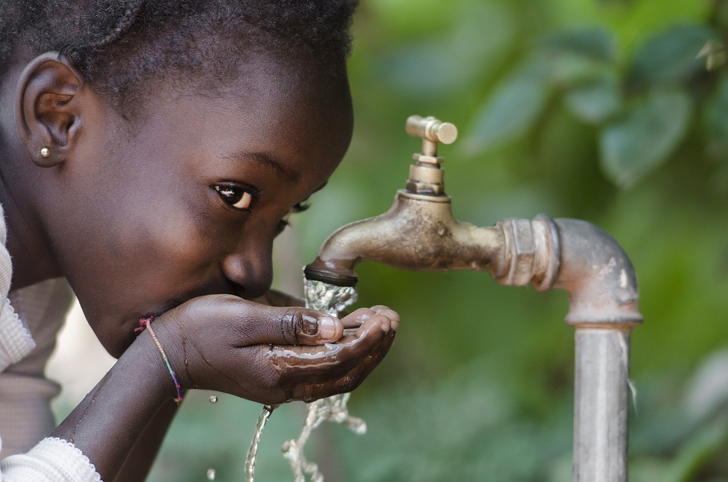 African girl drinking water