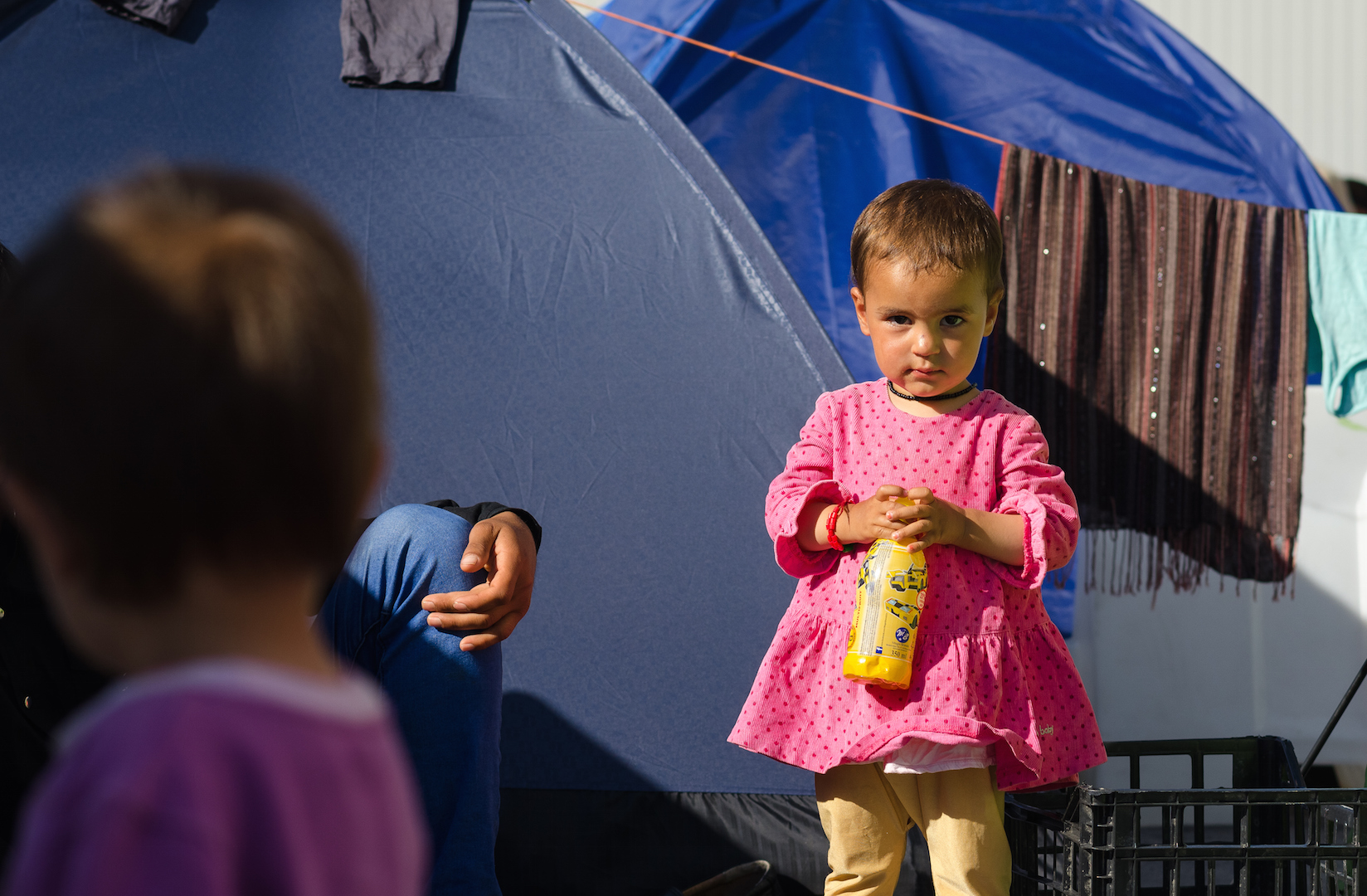 Little Syrian girl in a tent camp for refugee