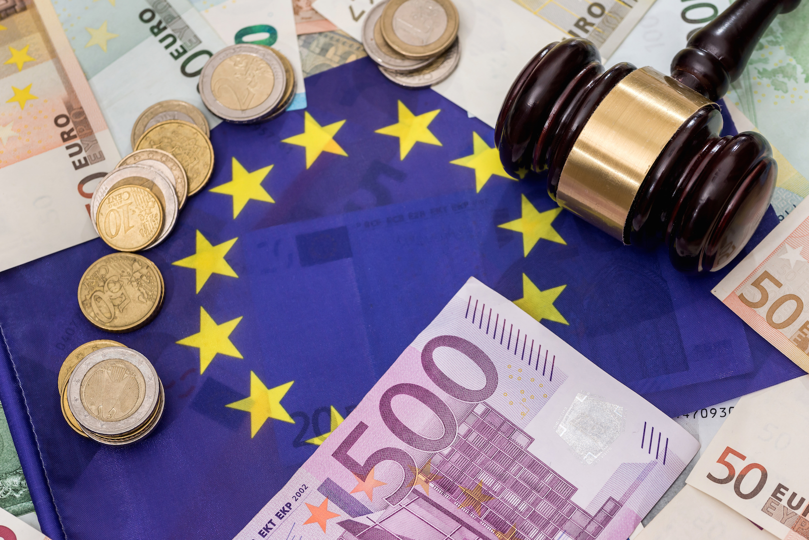 euro money, flag and gavel