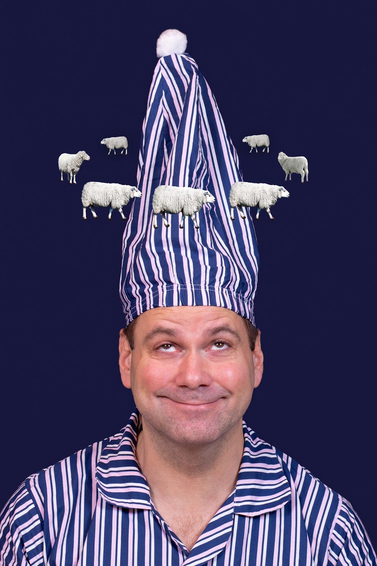 man in pajamas counts sheep