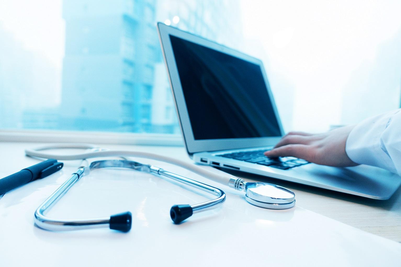Female doctor using laptop