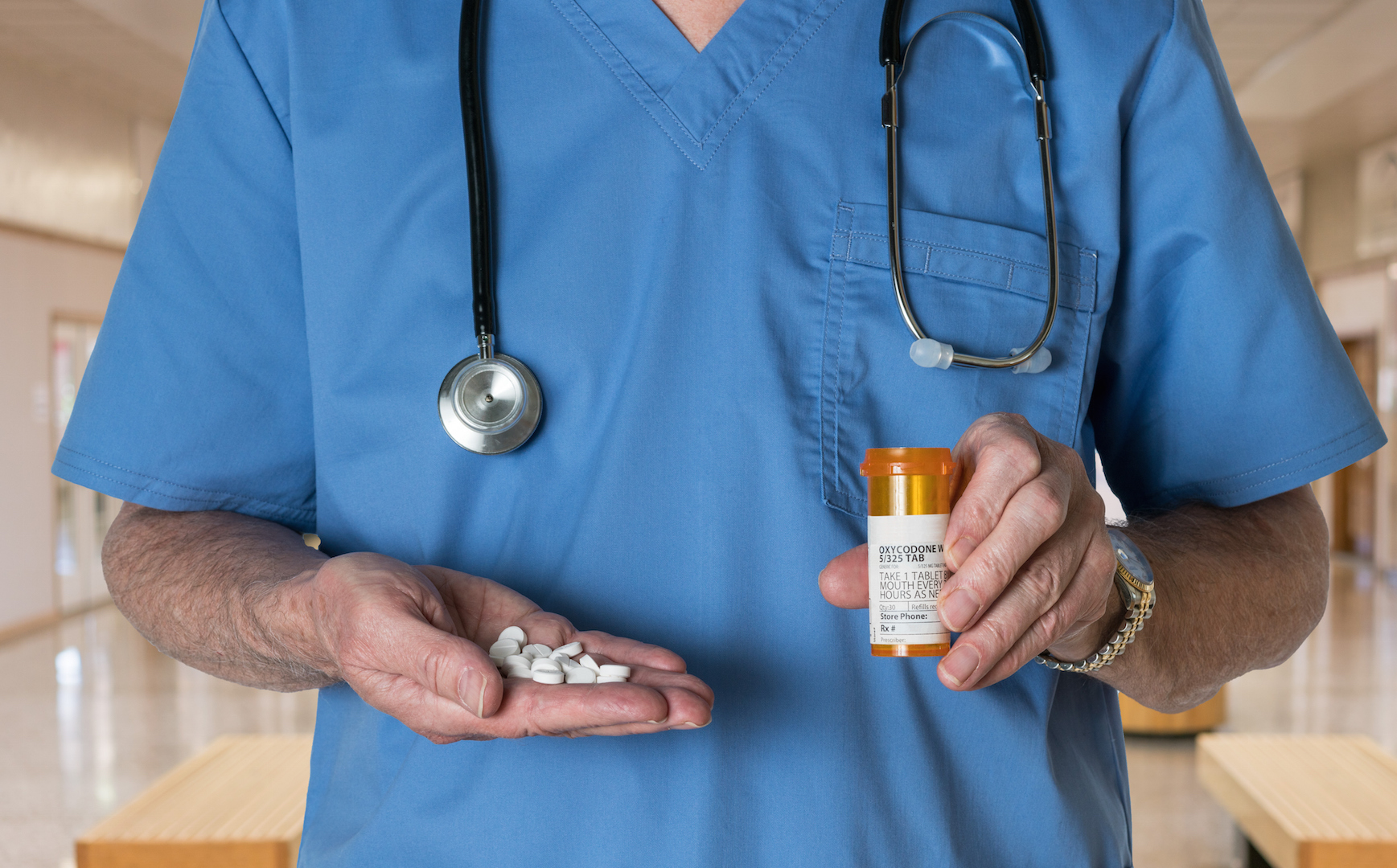 Generic oxycodone tablets in hands of doctor