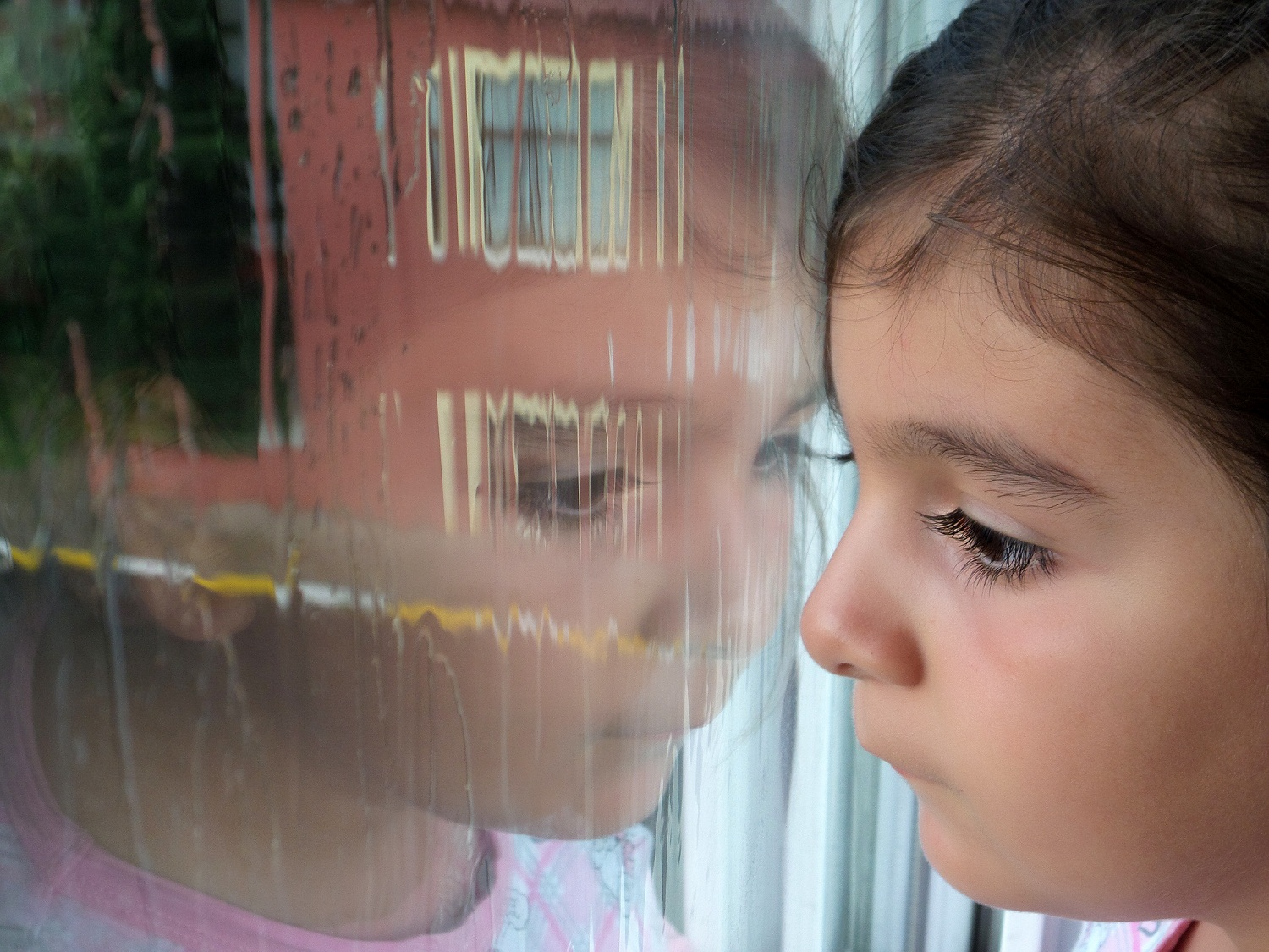 Child looking out window