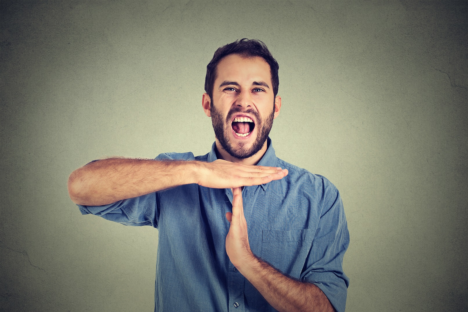 man showing time out hand gesture frustrated screaming stop