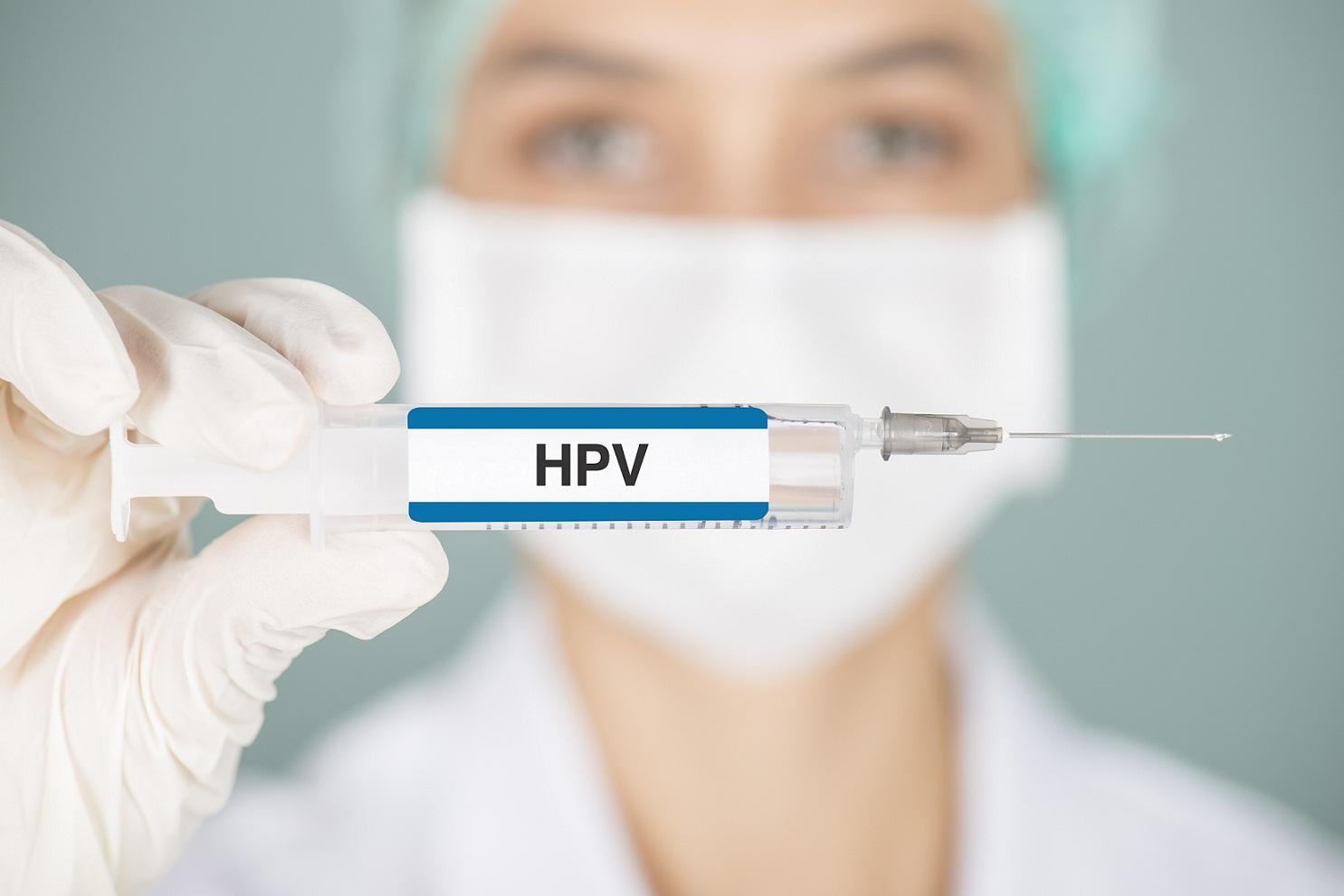 nurse holding up HPV vaccine