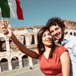 Italian couple waving flag