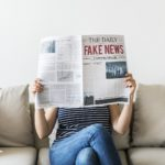 women reading fake news
