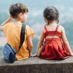 a little boy and little girl sitting